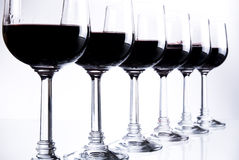 Six glasses of red wine. Or other beverage royalty free stock image