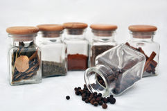 Six glasses of spice and allspice Stock Photo