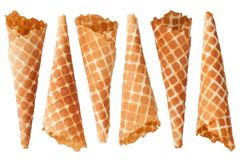 Six golden crispy ice cream waffle cones on white background isolated closeup top view royalty free stock photography