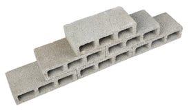 Construction Blocks Pyramid. Six gray concrete construction blocks (a.k.a. cinder block, breeze block, cement block, foundation block, besser block; professional Stock Photography