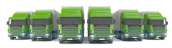Six green cargo trucks parked in a row Royalty Free Stock Photo