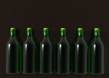 Six Green Glass Wine Bottles. On Black Royalty Free Stock Image