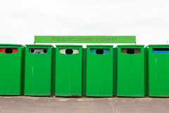 Six green recycling bins by recycling point to collect rubbish Royalty Free Stock Photo