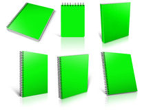 Six green spiral blank notepad on white. Royalty Free Stock Photos
