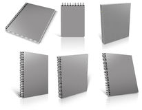 Six grey spiral blank notepad on white. Royalty Free Stock Photography