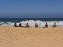 Six guys watching the surf Stock Image