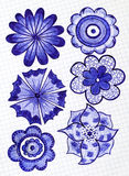 Six hand drawn flowers on the sheet of checkered paper Royalty Free Stock Photos