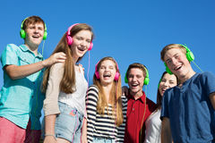 Six Happy Teens Laughing. Group of six happy teenagers laughing outdoors Royalty Free Stock Photography