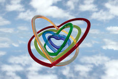 Six heart shapes flying with clouds Royalty Free Stock Image