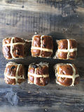 Six hot cross buns. In two rows on old wooden table Stock Photography