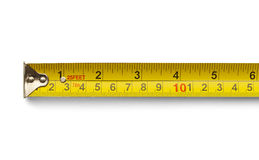 Six Inch Tape Measure. Six Inch Yellow Metal Tape Measure Isolated on a White Background Royalty Free Stock Image