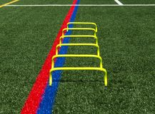 Six inch yellow mini hurdles stock image