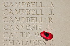 Six Inscribed names with Poppy. Six Names of missing World War One soldiers,  Tyne Cot Cemetery and Memorial to the Missing in Passendale, West-Flanders Royalty Free Stock Photo