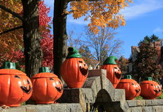 Six Jack-O-Lanterns on stonewall. Six big orange Jack-O-Lanterns set on old stonewall, grinning faces ready to scare any Trick-Or-Treaters that happen to walk by Royalty Free Stock Photos