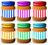 Six jars of peanut butters Stock Images
