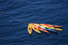 Six kayaks floating in the sea. Six kayaks tied together floating in the sea Royalty Free Stock Photography
