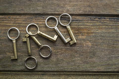 Six keys. Six golden keys on a wooden background. Copy space Stock Photography