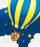 Six kids riding in the air balloon Stock Photos