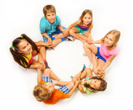 Six kids sit in a lotus pose Stock Photo