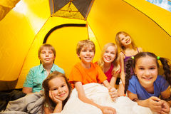 Six kids in a tent having fun together Royalty Free Stock Images