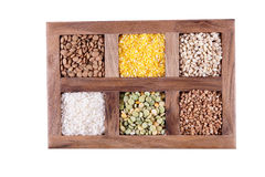 Six kinds of of groats vkorobochke with compartments. Stock Photos