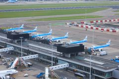 KLM jets parked at Schiphol. Six KLM Boeing 737 jets parked next to each other at B-pier at Schiphol Amsterdam Airport, the Netherlands royalty free stock photos