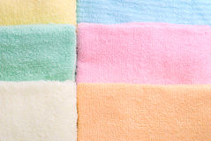 Six laid towels. Background and texture of six multi color towels laid side by side Royalty Free Stock Images