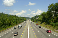 Six Lane Highway with Mid-day Traffic. A six-lane interstate highway with divider.  Lots of travelers on a late summer day. US Highway 640 in Knoxville Royalty Free Stock Photos