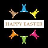 Six lapins de Pâques dans différentes couleurs avec le texte Photos stock