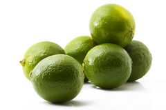 Six limes. Six green limes on white background royalty free stock images