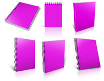 Six magenta spiral blank notepad on white. Stock Images