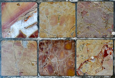 Six marble tiles. Six floor tiles of different marble textures Stock Images