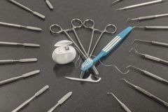 Six march, dentists day. Dentistry background with dentistry instruments stock image