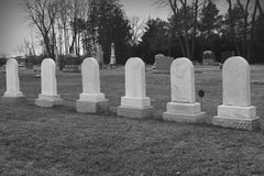 Six Matching Tombstones in Cemetary Stock Image