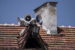 Six megaphones in blue sky on the roof Royalty Free Stock Photography