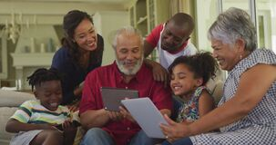 Multi-generation family spending time together at home