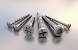 Six metal different screws next to each other Stock Photos