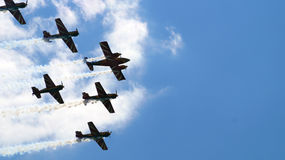 Six military propeller planes flying in the group Royalty Free Stock Photo