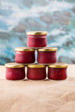 Six misted jam jars with berries. Close-up sacking and blue background royalty free stock image