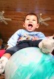 Six mois de chéri de sourire Photographie stock libre de droits