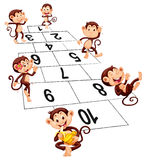 Six monkeys playing hopscotch Stock Images