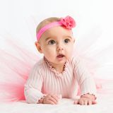 Six-month girl in a pink skirt Royalty Free Stock Image