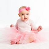 Six-month girl in a pink skirt Stock Photography