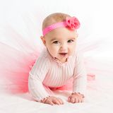 Six-month girl in a pink skirt Royalty Free Stock Photo