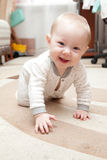 Six month old baby on the carpet Stock Photo