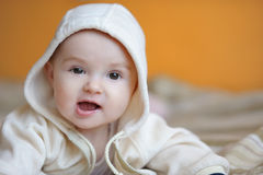 Six month old baby girl smiling Stock Photo