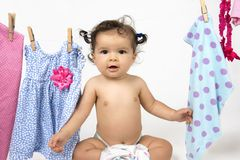 Mixed race baby in laundry line royalty free stock image
