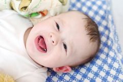 Six-months baby cries Stock Images