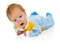 Six months child lying on floor isolated on white Royalty Free Stock Images