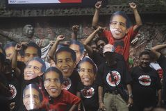 SIX MONTHS JOKOWI ADMINISTRATION. Supporters wear the mask of Indonesian President Joko Widodo and his VP Jusuf Kalla at Solo, Java, Indonesia. The Jokowi stock photo